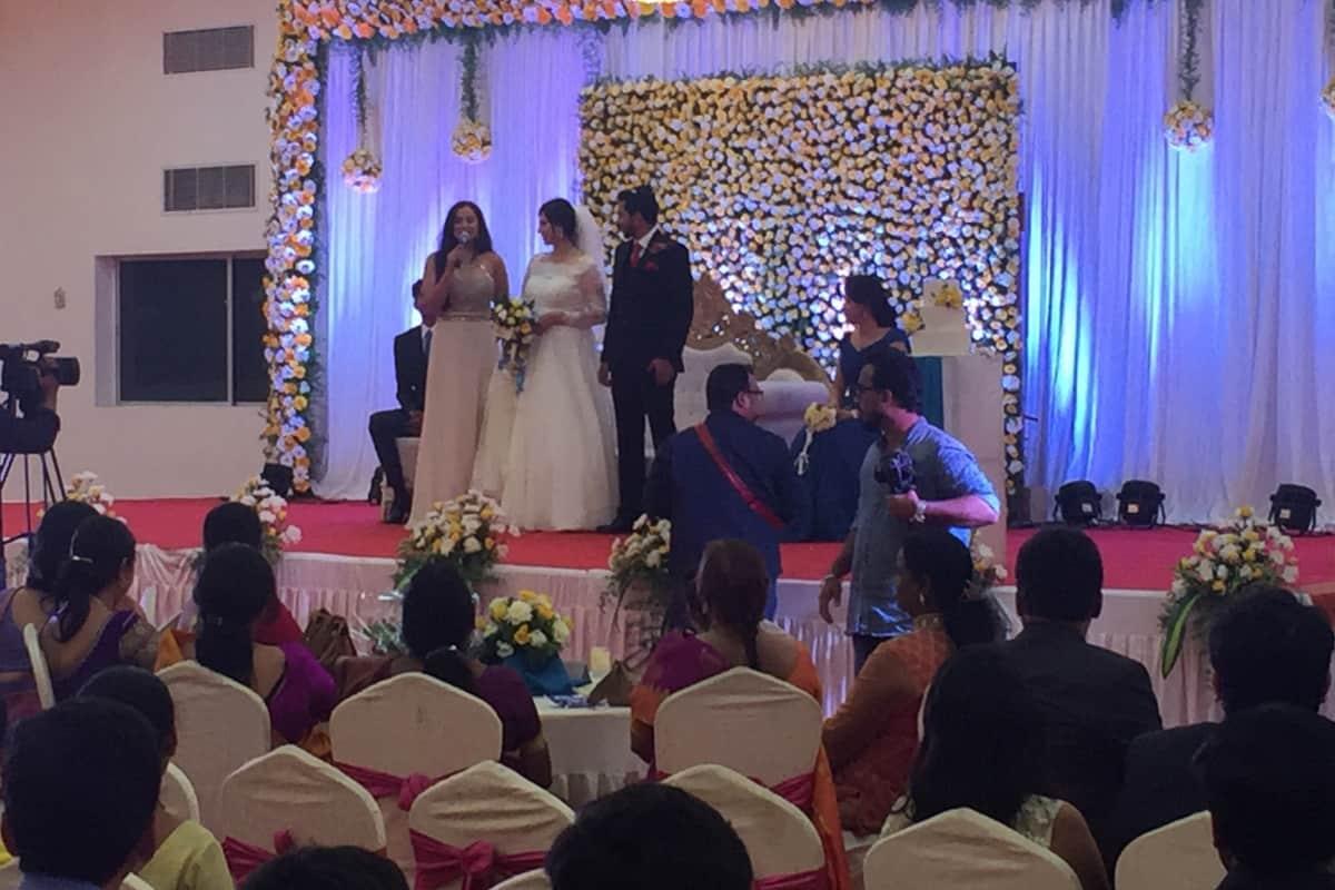 Multilingual MC Reena hosts Catholic Wedding reception